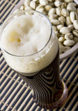 Beer with salty pistachio Stock Images