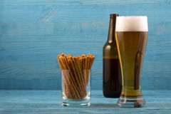 Beer and salty sticks stock photo