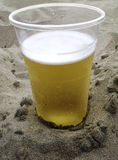 Beer in the sand Stock Image