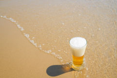 Beer on sand beach Stock Photo