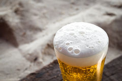 Beer on sand beach Stock Images