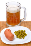Beer with sausage and green peas Stock Photos