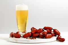 Beer and sausages Stock Images