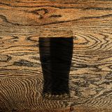 Beer scorched on oak. solid oak. wooden background. Fresh, tasty beer Stock Photography
