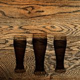 Beer scorched on oak. solid oak. wooden background. Fresh, tasty beer Stock Images