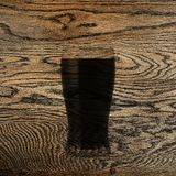 Beer scorched on oak. solid oak. wooden background. Fresh, tasty beer Stock Photos