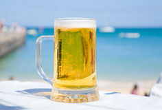 Beer in seaside caffee Stock Photography
