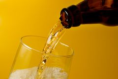 Beer served. Pouring beer into a glass Stock Images