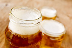 Beer served in glass jars Royalty Free Stock Photography