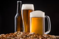 Beer served with snacks royalty free stock image