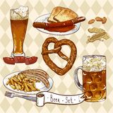 Beer Set with beer glasses, pretzel, sausages Royalty Free Stock Photography
