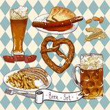 Beer Set with beer glasses, pretzel, sausages Royalty Free Stock Images