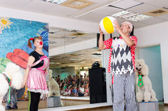 Beer-Sheva, ISRAEL - Clowns, two poodles and children , July 25, 2015 Royalty Free Stock Photos