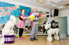 Beer-Sheva, ISRAEL - Clowns and two white poodle- July 25, 2015 Royalty Free Stock Photo