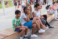 Ethiopian young girls and boys at new child amusement park at Beer-Sheva city. South Israel. BEER-SHEVA, ISRAEL - JULY 22, 2017: Ethiopian young girls and boys stock image