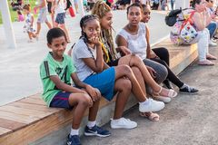 Ethiopian young girls and boys at new child amusement park at Beer-Sheva city. South Israel. BEER-SHEVA, ISRAEL - JULY 22, 2017: Ethiopian young girls and boys royalty free stock photo