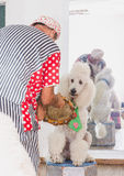Beer-Sheva, ISRAEL - Male clown and a white poodle , July 25, 2015 Stock Photo