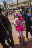 Beer-Sheva, ISRAEL - March 5, 2015:Beer-Sheva, ISRAEL - March 5, 2015: Girl in a suit and a hat pink ram, back view - Purim Royalty Free Stock Images
