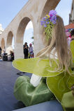 Beer-Sheva, ISRAEL - March 5, 2015:Beer-Sheva, ISRAEL - March 5, 2015: Portrait of a young blond woman with a flower in her hair. View from the back -Purim in Stock Image