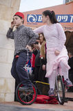 Beer-Sheva, ISRAEL - March 5, 2015:Boy and girl in a pink dress - before the performance on bicycles with one wheel - Purim Stock Photo