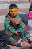 Beer-Sheva, ISRAEL - March 5, 2015:  A boy in a green suit ninja turtle in the yellow mask Royalty Free Stock Photography