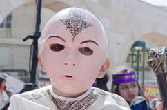 Beer-Sheva, ISRAEL - March 5, 2015: Boy in a suit and a pink mask of a human face Samurai - Purim. In the city of Beer-Sheva on March 5, 2015 in Israel Royalty Free Stock Images