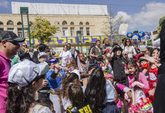 Beer-Sheva, ISRAEL - March 5, 2015: Children in carnival costumes catch the gifts on the Feast of Purim- Royalty Free Stock Photography