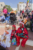 Beer-Sheva, ISRAEL - March 5, 2015: Children in scarlet and white carnival costumes - on the street - Purim Royalty Free Stock Photo