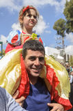 Beer-Sheva, ISRAEL - March 5, 2015: Girl in dress Disney Snow White on the shoulders of a smiling father against the sky - Purim Stock Photo