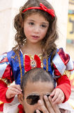 Beer-Sheva, ISRAEL - March 5, 2015: Girl dressed as Snow White Disney cartoon with a red bow on the shoulders of his father-Purim Royalty Free Stock Photo