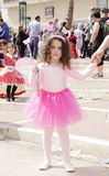 Beer-Sheva, ISRAEL - March 5, 2015: Girl in a pink blouse and skirt with wings holding the hand of her mother -Purim Royalty Free Stock Photos