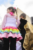 Beer-Sheva, ISRAEL - March 5, 2015:The girl in a pink dress with colored ruffles and boy in black are back - Purim Stock Image