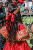 Beer-Sheva, ISRAEL - March 5, 2015:Girl in a red dress with a red crown with long hair standing with her back - Purim Royalty Free Stock Photography