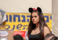 Jewish beautiful girl with mouse ears celebrate the Purim holiday at street event royalty free stock photos
