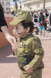 Beer-Sheva, ISRAEL - March 5, 2015: One year old kid in the costume of an Israeli soldier Golani with makeup - Purim Royalty Free Stock Photography