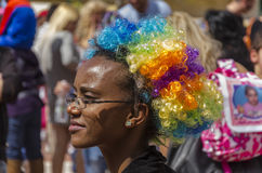 Beer-Sheva, ISRAEL - March 5, 2015:Portrait of black woman with glasses and curly clown wig color -Purim. In the city of Beer-Sheva on March 5, 2015 in Israel royalty free stock image
