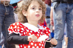 Beer-Sheva, ISRAEL - March 5, 2015: Portrait of the girl in a red dress with white pepper between people -Purim Stock Photos
