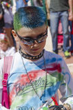 Beer-Sheva, ISRAEL - March 5, 2015: Portrait of a teenage boy with a green-blue dyed hair in black glasses, 2015, Israel Royalty Free Stock Image