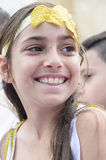 Beer-Sheva, ISRAEL - March 5, 2015: Smiling teen girl with a bandage artificial yellow leaf color -Purim Stock Photos
