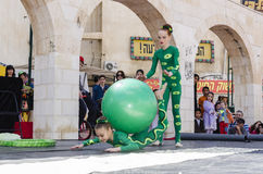 Beer-Sheva, ISRAEL - March 5, 2015: Two girl gymnast with a green ball Royalty Free Stock Images