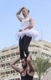 Beer-Sheva, ISRAEL - March 5, 2015: Two men, clowns, gymnasts, one of them in a tutu - with exercises on the open stage - Purim Royalty Free Stock Photography