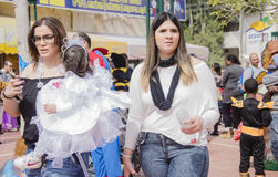 Beer-Sheva, ISRAEL - March 5, 2015:Two young women with a baby in a white dress on the one hand Purim Stock Photos