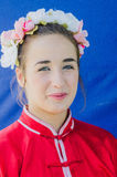 Beer-Sheva, ISRAEL -Portrait of a beautiful girl in a wreath and a scarlet kimono on a blue background, July 25, 2015 Royalty Free Stock Image