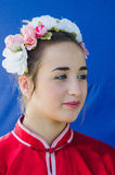 Beer-Sheva, ISRAEL -Portrait of a beautiful girl in a wreath and a scarlet kimono on a blue background, July 25, 2015 Stock Photo