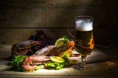 Beer with shrimp and fresh herbs. Still life with beer, shrimp and fresh herbs Royalty Free Stock Images