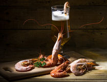 Beer with shrimp and fresh herbs. Still life with beer, shrimp and fresh herbs Stock Images