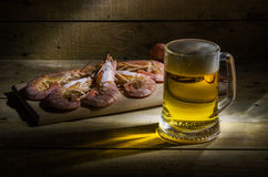 Beer with shrimp. Still life with beerand shrimps Royalty Free Stock Photo