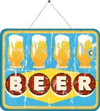 Beer sign. Grungy style hanging Royalty Free Stock Photography