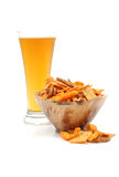Beer and Snack. Frosty beer with a heaping bowl of party mix Stock Images