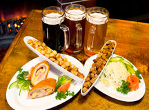 Beer with snack. Three glasses of different beer with snack Stock Photography